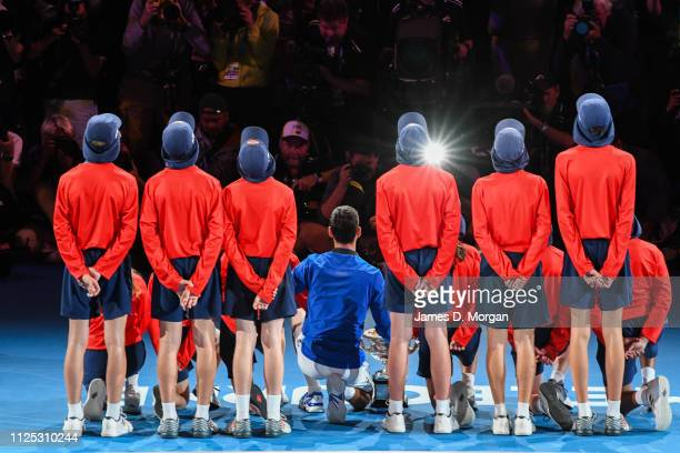 Novak Djokovic of Serbia poses with the Norman Brookes Challenge Cup and the ball boys following victory in his Men's Singles Final match against...