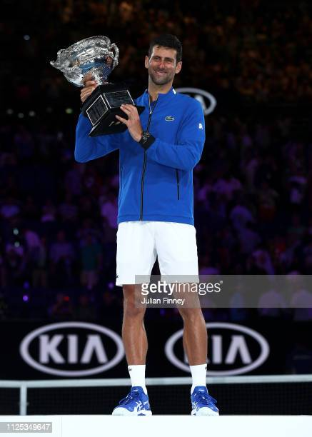 Novak Djokovic of Serbia poses with the Norman Brookes Challenge Cup following victory in his Men's Singles Final match against Rafael Nadal of Spain...