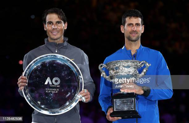 Novak Djokovic of Serbia poses with the Norman Brookes Challenge Cup following victory in his Men's Singles Final match along side runner up Rafael...