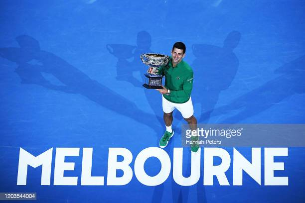 Novak Djokovic of Serbia poses with the Norman Brookes Challenge Cup after winning the Men's Singles Final against Dominic Thiem of Austria on day...