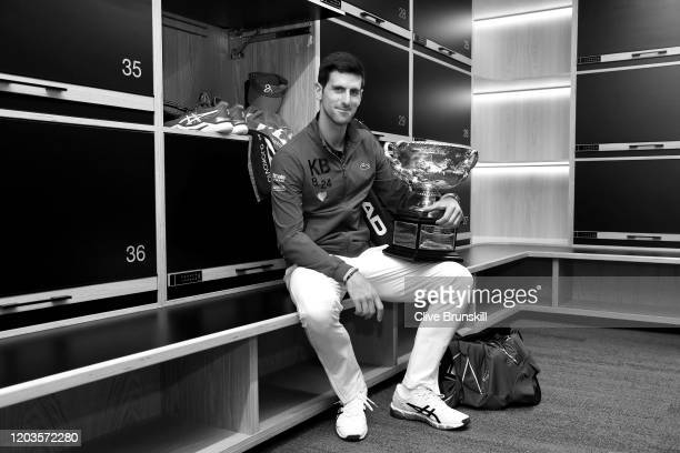 Novak Djokovic of Serbia poses with the Norman Brookes Challenge Cup in the locker room after winning the Men's Singles Final against Dominic Thiem...