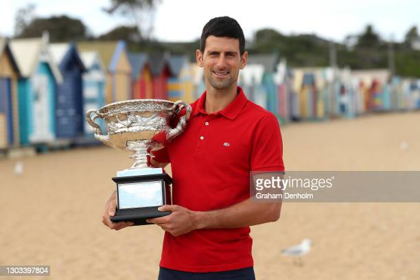 Novak Djokovic of Serbia poses with the Norman Brookes Challenge Cup after winning the 2021 Australian Open Men's Final, at XXXXX on February 22,...