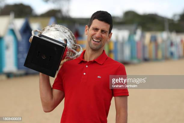Novak Djokovic of Serbia poses with the Norman Brookes Challenge Cup after winning the 2021 Australian Open Men's Final, at Brighton Beach on...