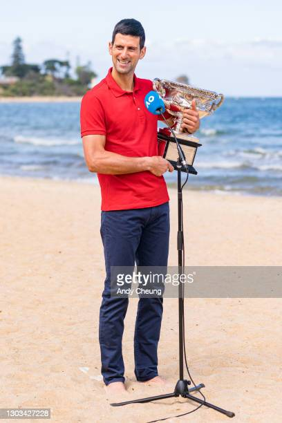 Novak Djokovic of Serbia poses with the Norman Brookes Challenge Cup and interviewed by the media, after winning the 2021 Australian Open Men's...