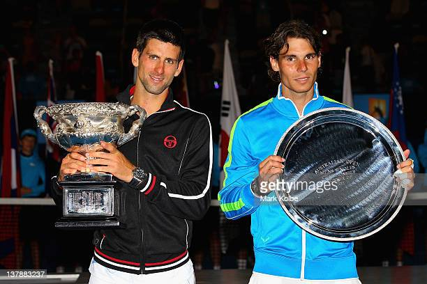 Novak Djokovic of Serbia poses with the Norman Brookes Challenge Cup alongside Raphael Nadal of Spain with the runnersup trophy after winning the...