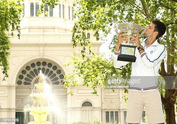 Novak Djokovic of Serbia poses with the Norman Brookes Challenge Cup after winning the 2012 men's Australian Open, at Carlton Gardens on January 30,...