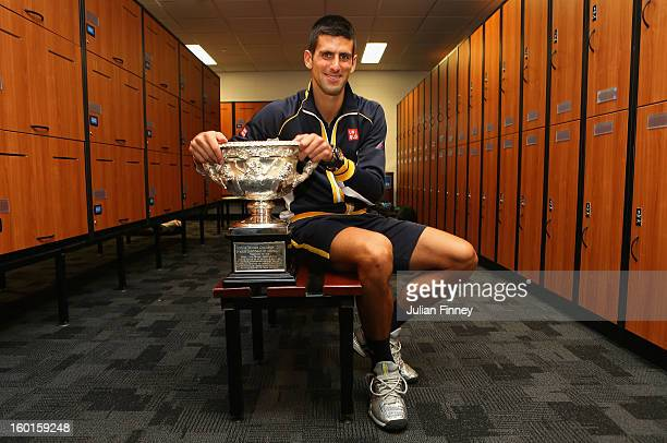 Novak Djokovic of Serbia poses with the Norman Brookes Challenge Cup in the changerooms after winning his men's final match against Andy Murray of...