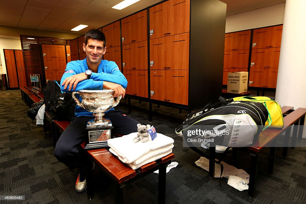 Novak Djokovic of Serbia poses with the Norman Brookes Challenge Cup after winning his men's final match against Andy Murray of Great Britain during day 14 of the 2015 Australian Open at Melbourne Park on February 2, 2015 in Melbourne, Australia.
