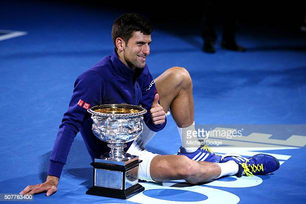 Novak Djokovic of Serbia poses with the Norman Brookes Challenge Cup after winning the Men's Singles Final over Andy Murray of Great Britain during...