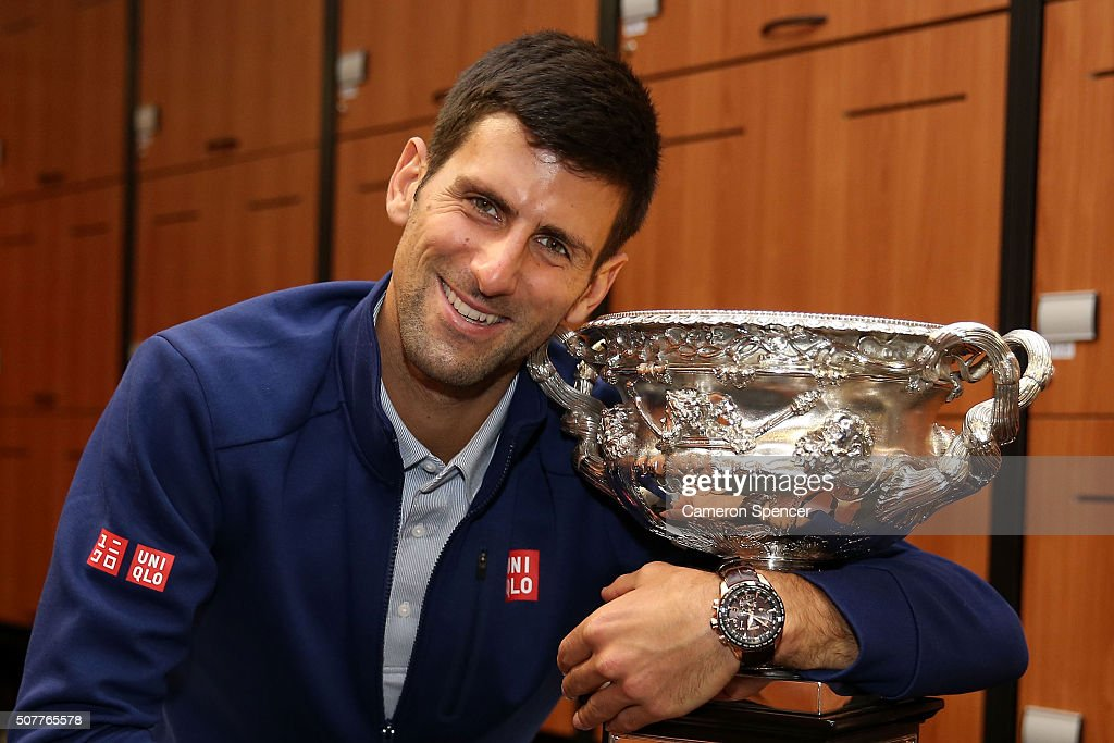 Novak Djokovic of Serbia poses with the Norman Brookes Challenge Cup in the players change rooms after winning the Men's Singles Final against Andy Murray of Great Britain during day 14 of the 2016 Australian Open at Melbourne Park on February 1, 2016 in Melbourne, Australia.