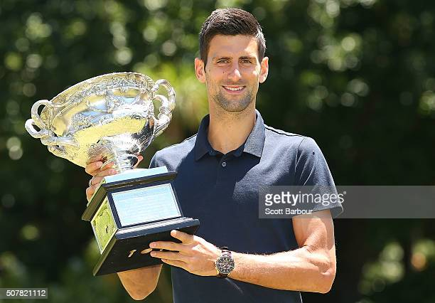 Novak Djokovic of Serbia poses with the Norman Brookes Challenge Cup after winning the Men's Singles Final during the Australian Open 2016 Men's...