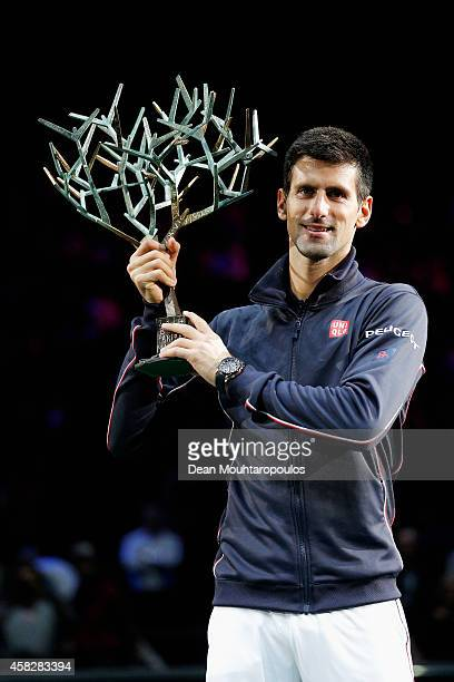 Novak Djokovic of Serbia poses with the trophy after victory against Milos Raonic of Canada in their Final during day 7 of the BNP Paribas Masters...