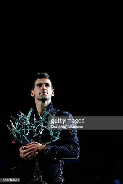 Novak Djokovic of Serbia poses with the trophy after victory against Milos Raonic of Canada in their Final match during day 7 of the BNP Paribas...