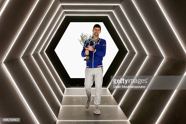 Novak Djokovic of Serbia poses with the trophy after victory against Andy Murray of Great Britain in their Mens Final match during Day 7 of the BNP...