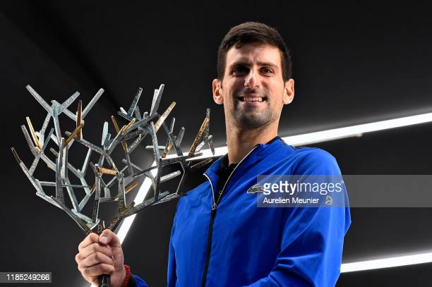 Novak Djokovic of Serbia poses with the trophy after winning his Men's Singles Final match against Denis Shapovalov of Canada on day 7 of the Rolex...