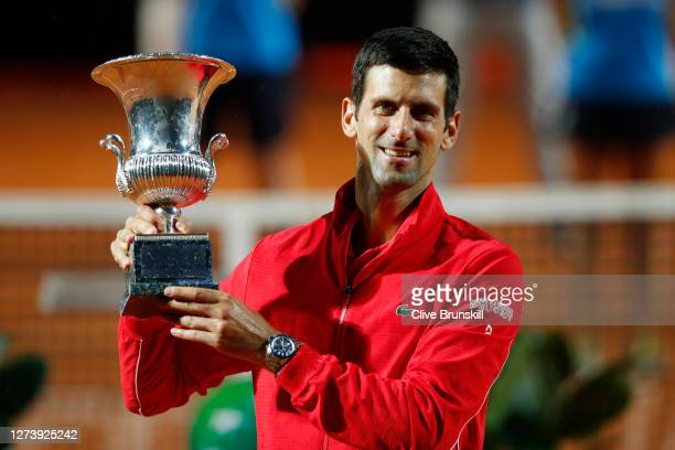 Novak Djokovic of Serbia poses with the trophy after winning his men's final match against Diego Schwartzman of Argentina during day eight of the...