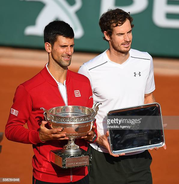 Novak Djokovic of Serbia poses with the trophy after winning the men's single final match against Andy Murray of United Kingdom at the French Open...