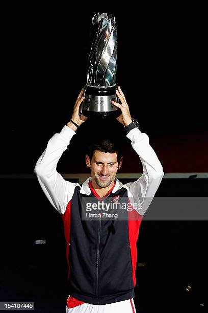 Novak Djokovic of Serbia poses with the winner's trophy after defeating Andy Murray of Great Britain during the final of the Shanghai Rolex Masters...