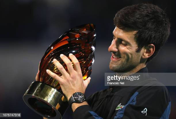 Novak Djokovic of Serbia poses with the winners trophy after winning the Mubadala World Tennis Championship at International Tennis Centre Zayed...