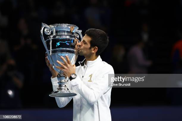 Novak Djokovic of Serbia poses with the World Number one trophy during Day One of the Nitto ATP Finals at The O2 Arena on November 11 2018 in London...