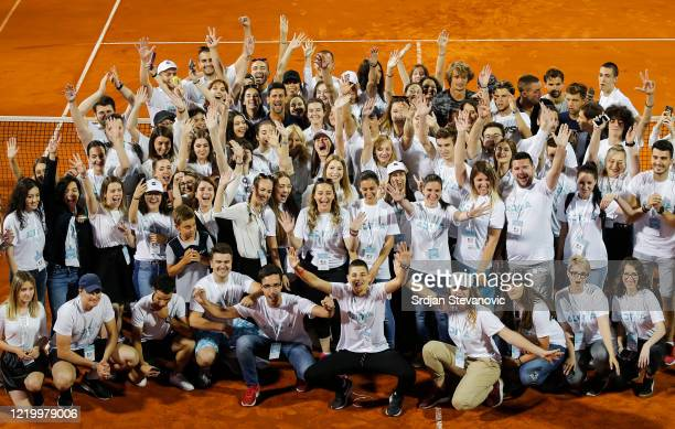 Novak Djokovic of Serbia poses with volunteers after the final match between Dominic Thiem of Austria and Filip Krajinovic of Serbia at the Adria...