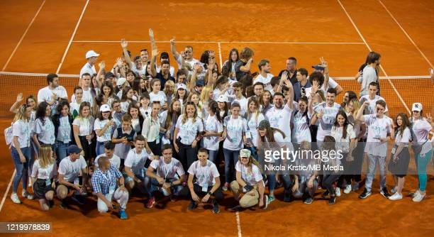 Novak Djokovic of Serbia posing for photographers with tournament volunteers at the end of the final match on June 14 during the 3rd day of Summer...