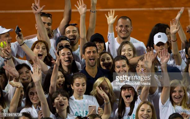 Novak Djokovic of Serbia posing for photographers with tournament volunteers on June 14 during the 3rd day of Summer Adria Tour 2020 in Belgrade...