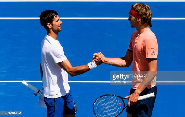 Novak Djokovic of Serbia practices with Alexander Zverev of Germany before the start of the US Open at the USTA Billie Jean King National Tennis...