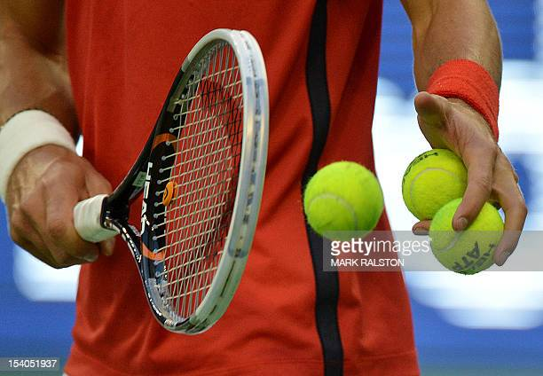 Novak Djokovic of Serbia prepares to serve against Tomas Berdych of the Czech Republic during their semifinals match at the Shanghai Masters tennis...