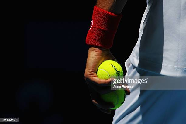 Novak Djokovic of Serbia prepares to serve in his fourth round match against Lukasz Kubot of Poland during day eight of the 2010 Australian Open at...