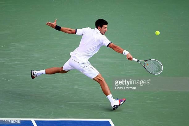 Novak Djokovic of Serbia reaches for a return against Rafael Nadal of Spain during the Men's Final on Day Fifteen of the 2011 US Open at the USTA...