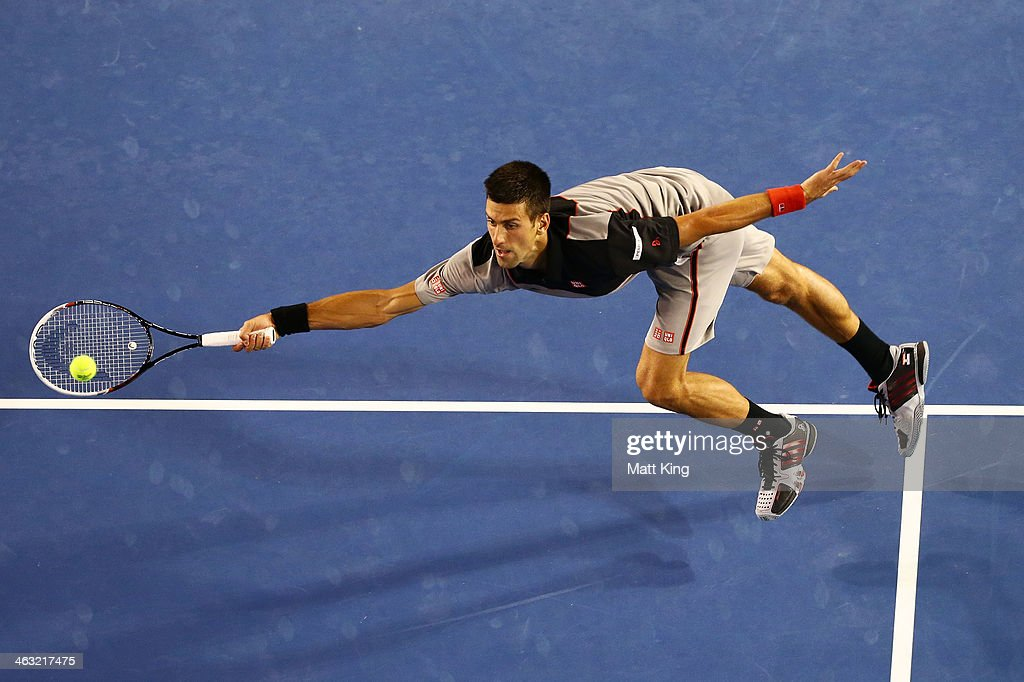 Novak Djokovic of Serbia reaches out to play a forehand volley in his third round match against Denis Istomin of Uzbekistan during day five of the 2014 Australian Open at Melbourne Park on January 17, 2014 in Melbourne, Australia.