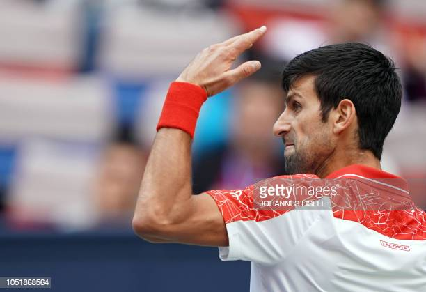Novak Djokovic of Serbia reacts after a return against Marco Cecchinato of Italy during their men's singles third round match at the Shanghai Masters...