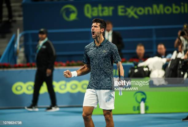 Novak Djokovic of Serbia reacts after defeating Nikoloz Basilashvili of Georgia during their ATP Qatar Open tennis quarterfinal match in Doha on...