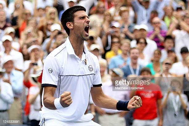 Novak Djokovic of Serbia reacts after he won his match against Roger Federer of Switzerland during Day Thirteen of the 2011 US Open at the USTA...