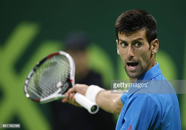 Novak Djokovic of Serbia reacts after losing a point against Andy Murray of Great Britain during the men's singles final match of the ATP Qatar Open...
