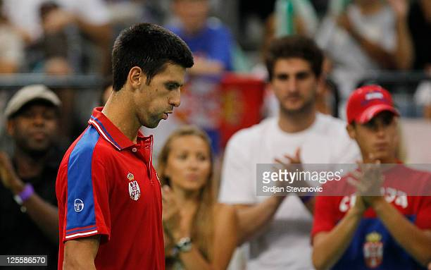 Novak Djokovic of Serbia reacts after losing a point against Juan Martin Del Potro of Argentina during the Davis Cup singles semi final between...