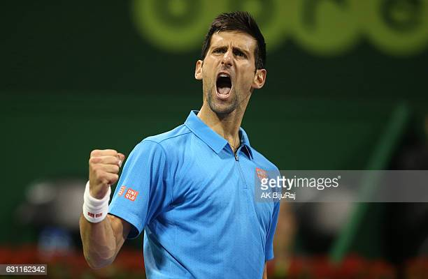 Novak Djokovic of Serbia reacts after winning a point against Andy Murray of Great Britain during the men's singles final match of the ATP Qatar Open...
