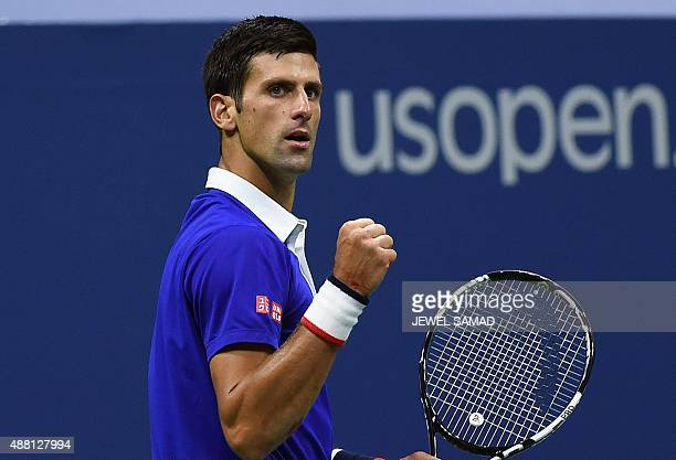 Novak Djokovic of Serbia reacts after winning a point against Roger Federer of Switzerland during their 2015 US Open Men's singles final match at the...