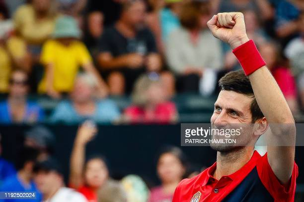 Novak Djokovic of Serbia reacts after winning against Cristian Garin of Chile in the men's singles match on day six of the ATP Cup tennis tournament...