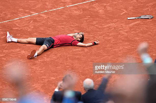 Novak Djokovic of Serbia reacts after winning his men's singles final match against Andy Murray of Great Britain on day fifteen of the 2016 French...