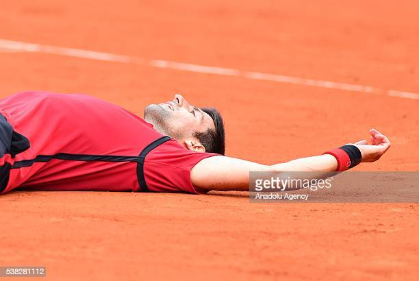 Novak Djokovic of Serbia reacts after winning the men's single final match against Andy Murray of United Kingdom at the French Open tennis tournament...