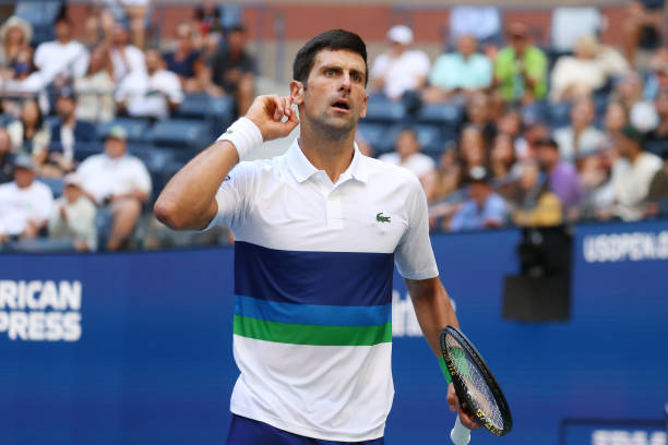 Novak Djokovic of Serbia reacts against Kei Nishikori of Japan during his Men's Singles third round match of the 2021 US Open at the USTA Billie Jean...