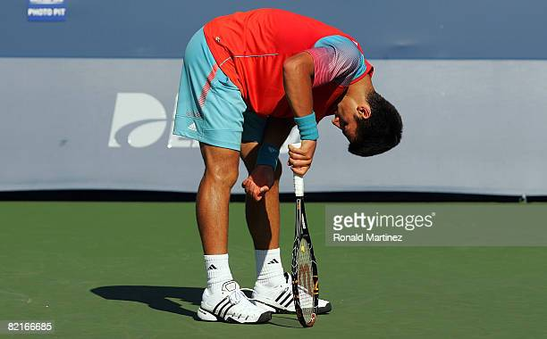 Novak Djokovic of Serbia reacts between games with Andy Murray of Great Britain in the finals of the Western Southern Financial Group Masters on...