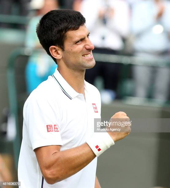 Novak Djokovic of Serbia reacts during his Gentlemen's Singles quarterfinal match against Marin Cilic of Croatia on day nine of the Wimbledon...