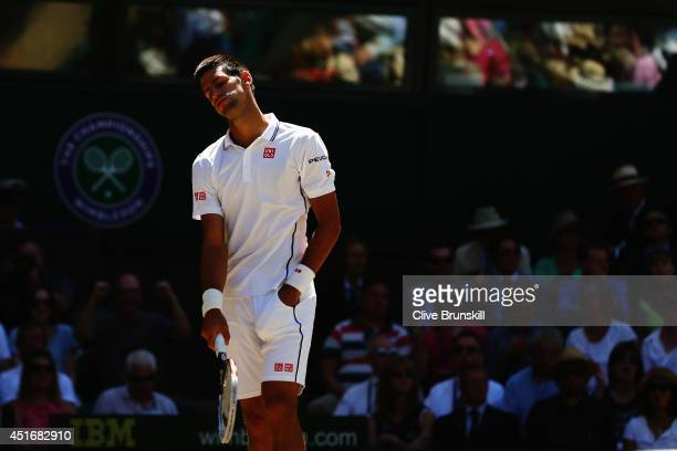 Novak Djokovic of Serbia reacts during his Gentlemen's Singles semifinal match against Grigor Dimitrov of Bulgaria on day eleven of the Wimbledon...