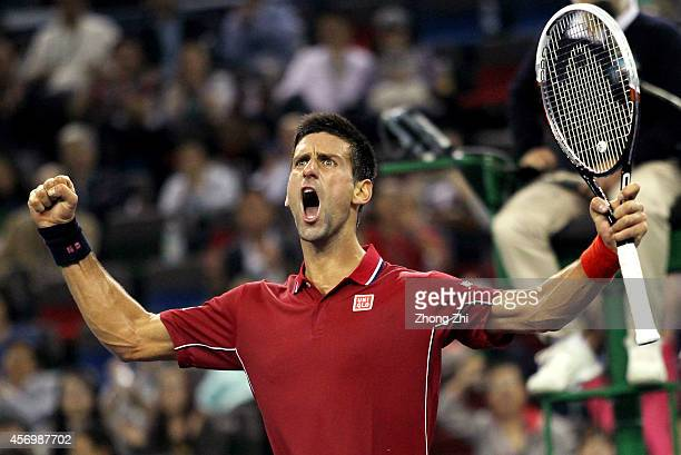 Novak Djokovic of Serbia reacts during his match against David Ferrer of Spain during the day 6 of the Shanghai Rolex Masters at the Qi Zhong Tennis...