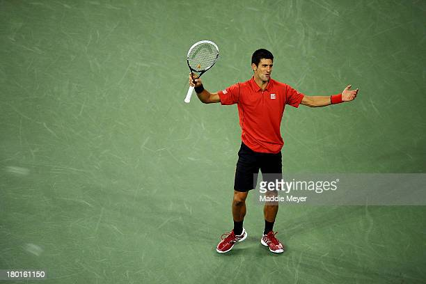 Novak Djokovic of Serbia reacts during his men's singles final match against Rafael Nadal of Spain on Day Fifteen of the 2013 US Open at the USTA...