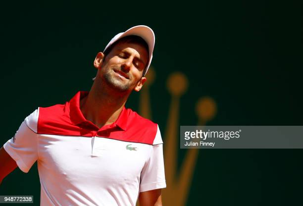 Novak Djokovic of Serbia reacts during his men's singles match against Dominic Thiem of Austria on day five of the Rolex MonteCarlo Masters at...