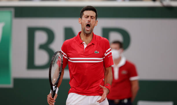 Novak Djokovic of Serbia reacts during his Mens Singles Quarter-Final match against Matteo Berrettini of Italy during Day Eleven of the 2021 French...